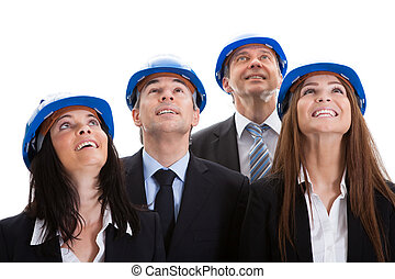 Happy Architects Looking Up - Portrait Of Happy Architects...