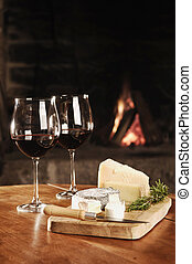 Two Glasses Of Red Wine At A Cosy Fireplace - Two Glasses Of...