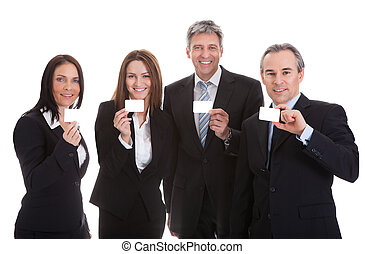 Businesspeople Holding Visiting Card - Happy Businesspeople...