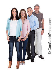 Happy Businesspeople Standing In Row - Group Of Happy...