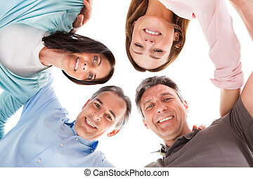Happy People Making Huddle - Group Of Happy People Making...