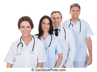 Group Of Doctor Standing In A Row - Group Of Happy Doctor...