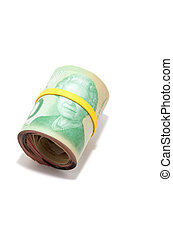 Roll of twenty Canadian dollars isolated on white background...