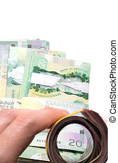A roll of bank notes focusing on a 20 Canadian dollars