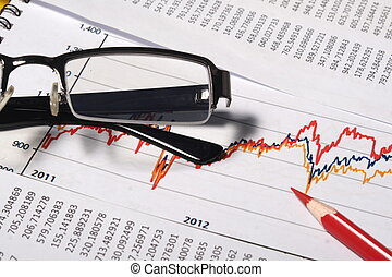 Financial or accounting concept - business chart, eyeglass