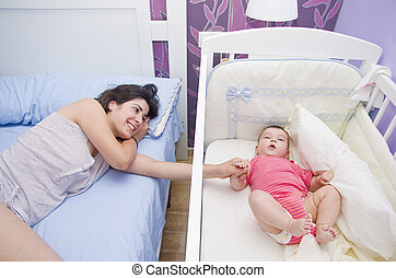 Mother and baby together in the bedroom.