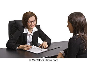 Business interview - Two businesswomen at an interview in an...