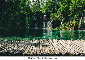 Lake in forest with wooden walk