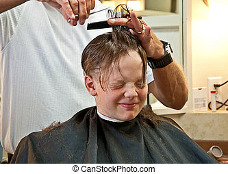 Boy Getting Haircut - This 9 year old Caucasian boy is...