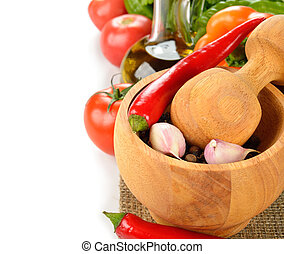 Wooden mortar and fresh vegetables