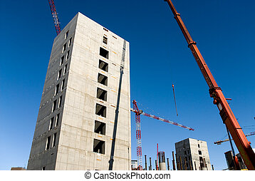 building yard - concrete structure and crane against a...