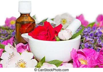 Essential oil and rose blossoms in mortar