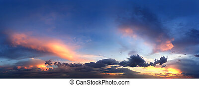 Panorama of evening sunset sky with clouds