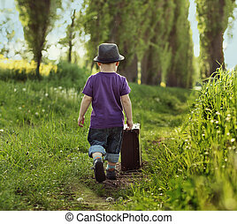 Little child carrying a suitcase - Little kid carrying a...