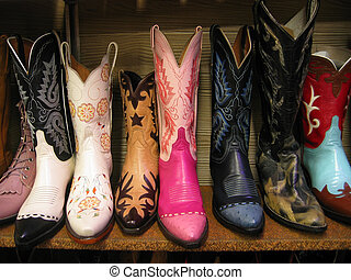 colorful cowboy boots - A row of colorful cowboy boots on a...