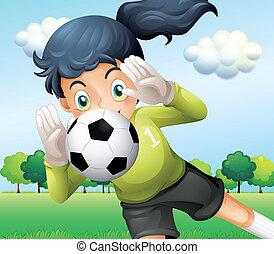 A girl catching a soccer ball