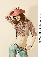 Woman in red cowboy hat, jeans and shirt