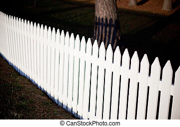 White Picket Fence - Green grass with a white picket fence.