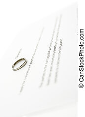 Divorce papers - Detail of wedding ring on divorce papers.