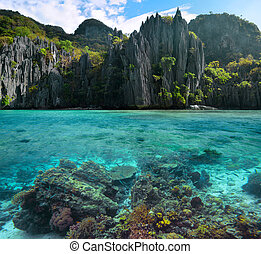 Photo of sharp cliffs and colorful coral reefs in the...
