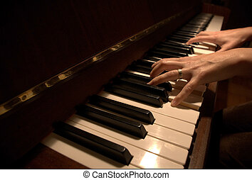 hands on piano - a pair of woman\\\'s hands playing a petrof...