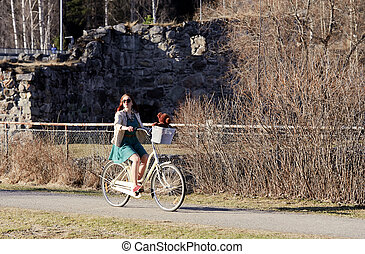 Girl riding a bike in the park