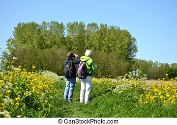 Bird watching - Two ladies spotting birds in nature reserve...