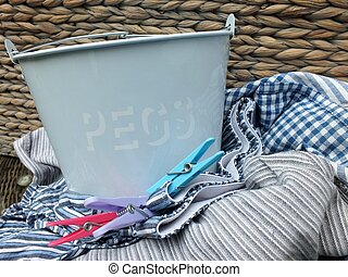 Wash day - Retro peg tin with pegs and pile of laundrey