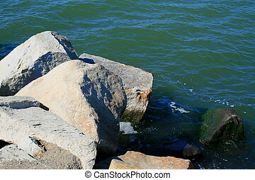 Rocky Shore - Rocky shore with beautiful and clear water.