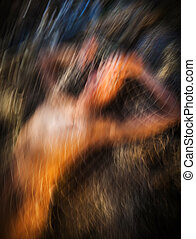 Motion blur image of naked woman in fishing net