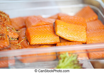 Fishes Displayed In Container At Store - Closeup of sliced...