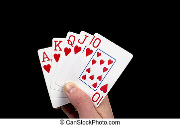 Royal Flush Hand - A male hand holds a good poker hand...