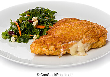 Chicken Cordon Bleu - Chicken cordon bleu with a small green...