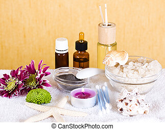 Aromatherapy - Two bottles of essence oil and chrysanthemum....