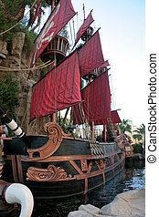 Pirate Ship - A black and red pirate ship one water