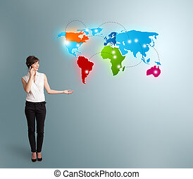 young woman making phone call with colorful world map -...