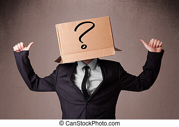 Businessman standing and gesturing with a cardboard box on...