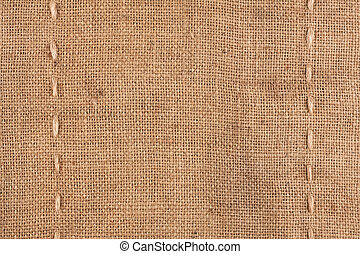 The two vertical stitching on the burlap as background