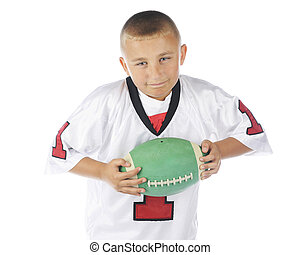 Football Intensity - Close-up of an elementary boy intensely...