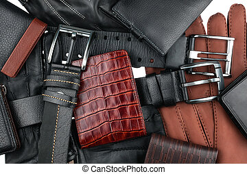 Men's wallet lying on the belts and gloves isolated on white