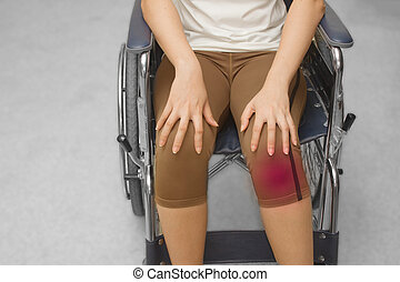 an injured woman in a wheelchair