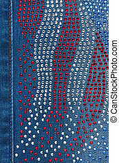 Yellow seam on denim with rhinestones, background, texture
