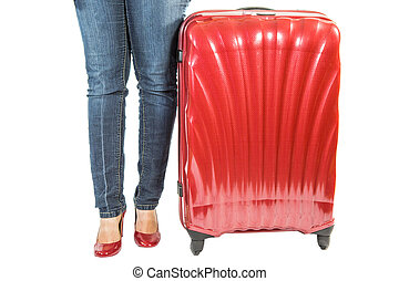 Female and Luggage - Female legs with red luggage bag over...