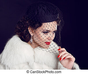 Retro lady. Beautiful Woman in Luxury Fur Coat.  Fashion model Isolated on dark background.
