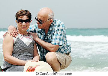 Happy elderly couple enjoying their retirement vacation near...