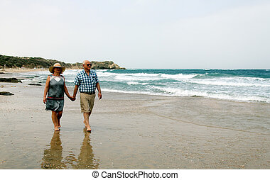 Happy elderly couple enjoying their vacation near the sea