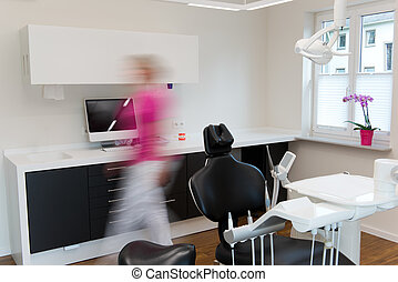 Blurred Motion Of Woman Walking At Dentist's Office -...