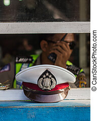 Police cap - a police cap  of Police man in Bali Indonesia