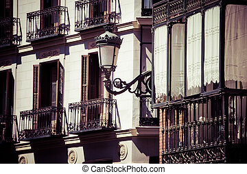 decorated facade and balconies at the Palza...