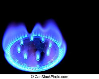 Natural gas - Natural gas, bringing warmly on a black...